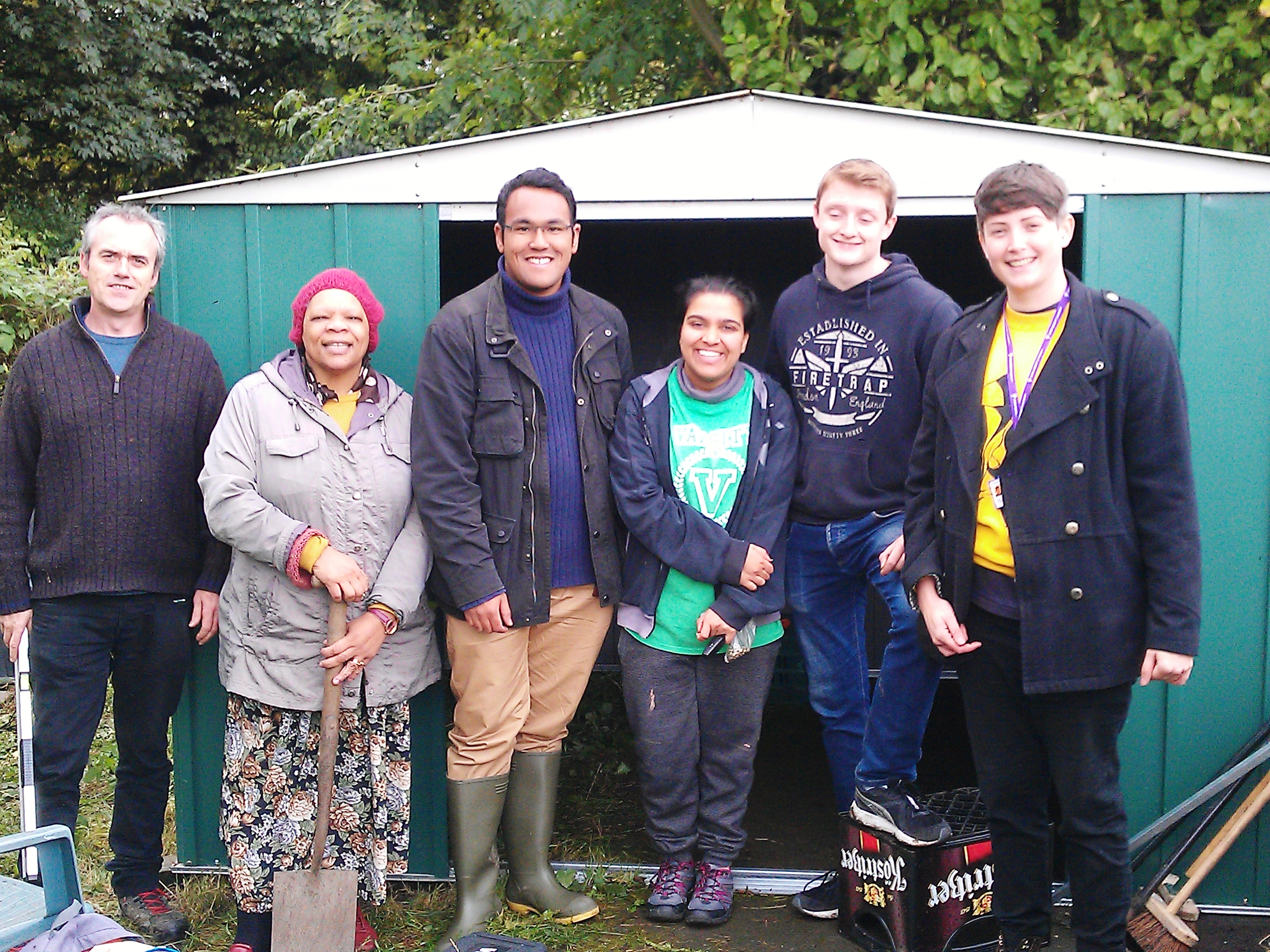 Erecting the Allotment shed with local students